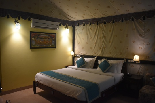 Inside of delux tent at durshet forest lodge adventure resort near pune.JPG